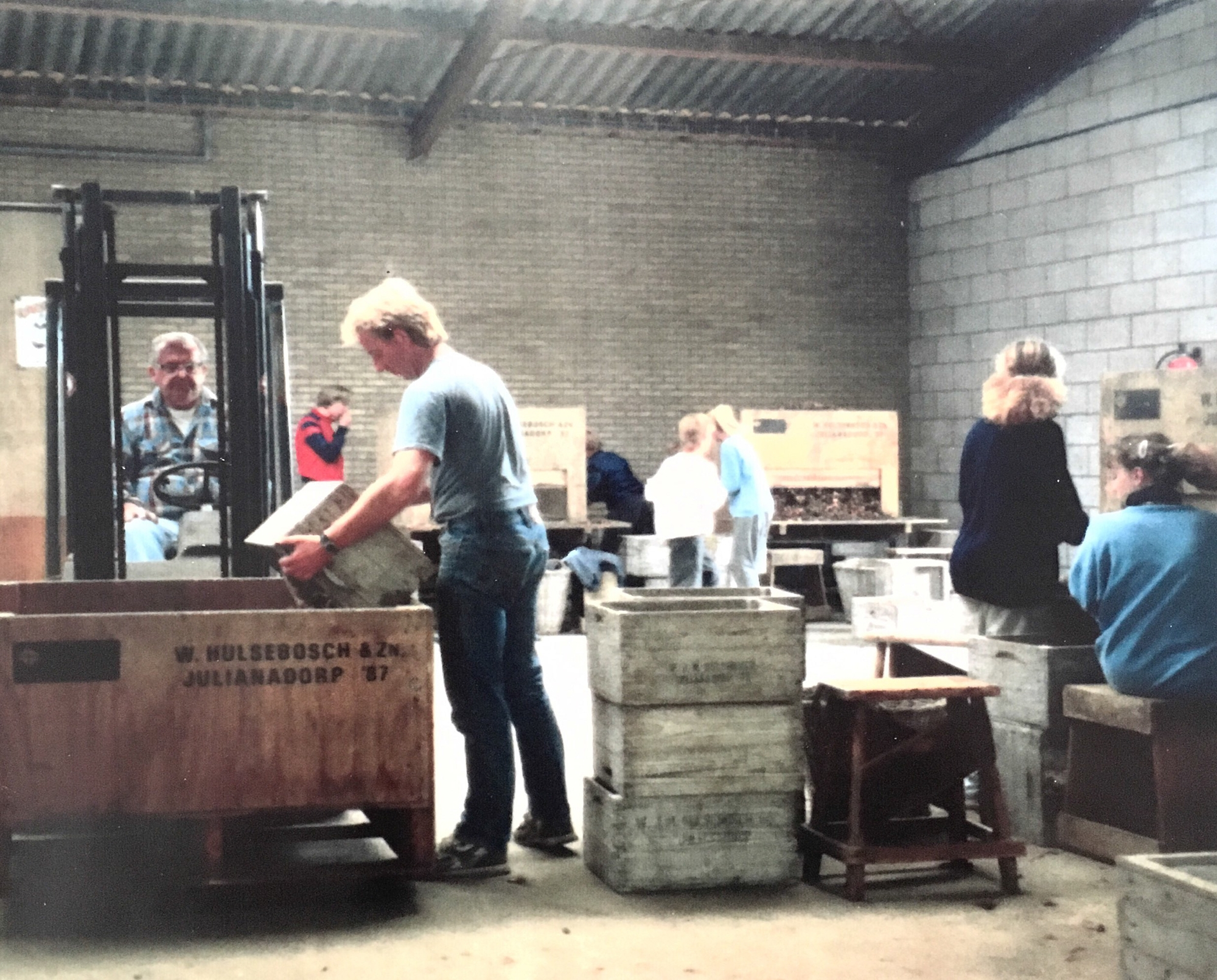 Willem and Debby's father, Steve, on the forklift (1990)